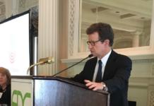 Art Bilger speaking at podium