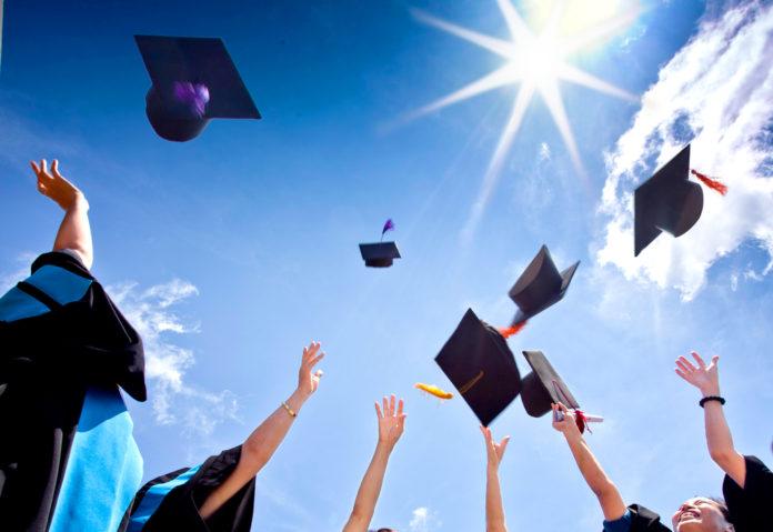 graduation caps flying