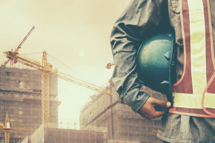 construction worker holding hardhat