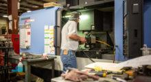 Ashby machinist Mike Genser operates the Doosan DNM 500 CNC lathe.