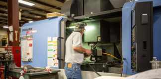 Ashby machinist Mike Genser operates the Doosan DNM 500 CNC lathe.