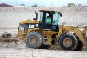 Marina Araujo on bulldozer at construction site.