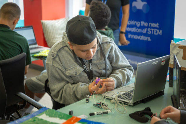 Students learn computer coding skills at the Qualcomm Thinkabit Lab.
