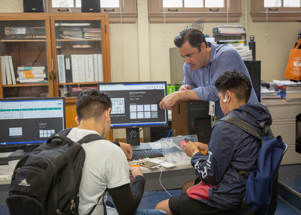 Ryan Flores teaches Digital Electronics at John Muir High School in Pasadena, Calif. He is one of the many STEM professionals who have transitioned to teaching jobs through EnCorps.