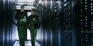 Military cybersecurity experts working with servers.