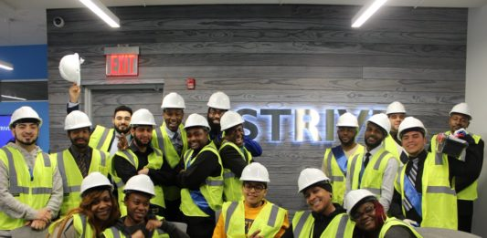 STRIVE New York construction graduates celebrate their entry into the workforce. Image via STRIVE International Twitter.