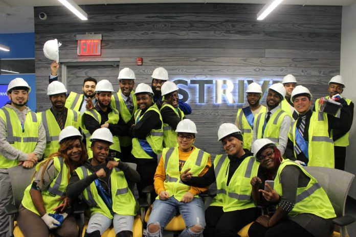STRIVE New York construction graduates celebrate their entry into the workforce. Image via STRIVE International Twitter.