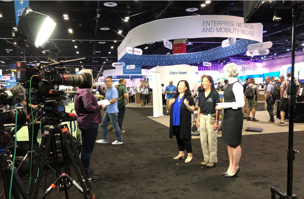 Cisco SVP Tae Yoo interviewed on camera at Cisco Live.