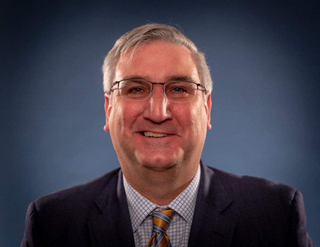 Photo of Indiana Gov. Eric Holcomb who brought over The Last Mile to Indiana.