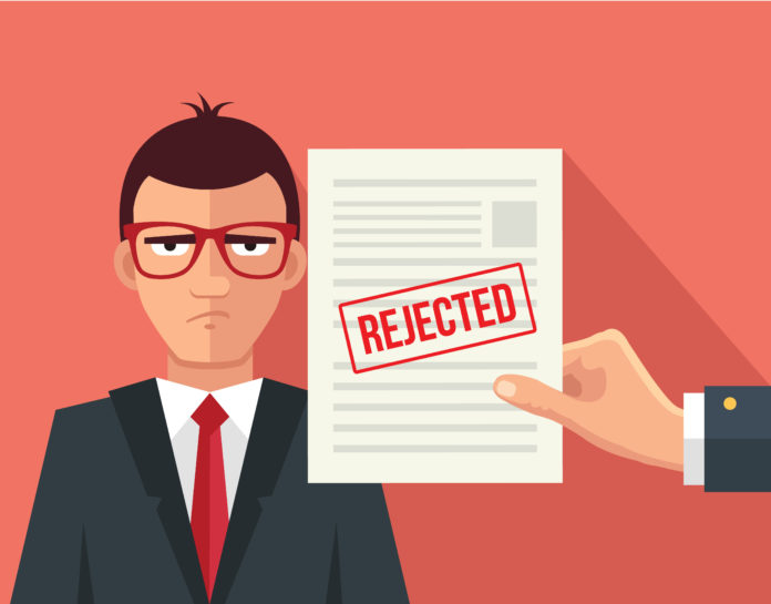 Image of guy being rejected at work.