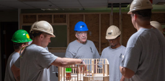 HBI instructor Lawrence Morris with HBI students training them for construction careers.