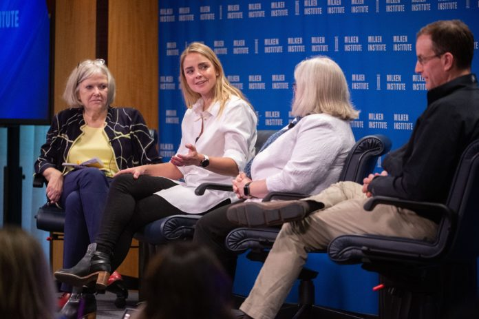 Photo of Jane Oates' panel at the Town Hall.