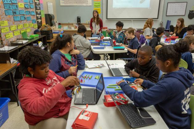 UTeach graduate Kira Lowery holds class at NYOS Charter School.