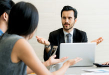 male partners arguing, funny easygoing woman keeping calm in stressing situation