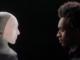 robot interviewing man