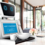 Robot server delivers order to table.