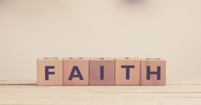 Faith spelled out in wood blocks on table