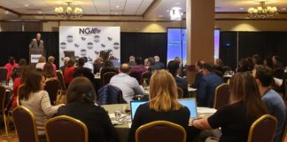 National Governors Association Chair, Gov. Steve Bullock of Montana, addresses Good Jobs for All Americans summit attendees.