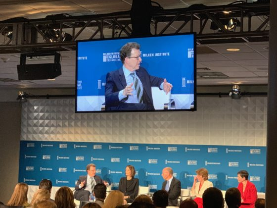 WorkingNation Founder and CEO Art Bilger seen on screen speaking at Milken Global Conference 2019.