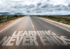"""Road with words """"learning never ends"""" on it"""
