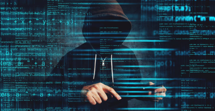 Man in hoodie with no face with data over him