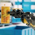 Robot arm holds prescription bottle