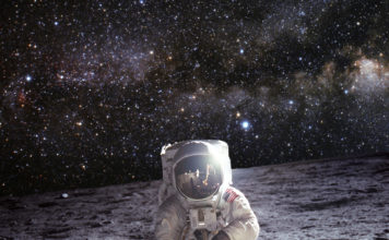 Astronaut on the Moon with universe stars background