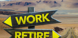 Work or retire crossroads - road signs.