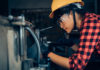 woman working on manufacturing floor