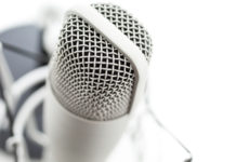 podcast microphone on white background