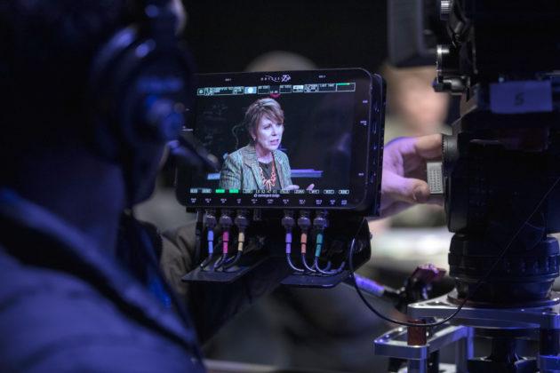 Carol Eggert on studio camera monitor
