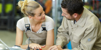 Man and woman work together in workshop