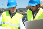 Two solar energy workers on job site